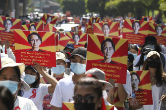 Anti-coup protesters held posters of deposed Myanmar leader Aung San Suu Kyi as they gathered outside the UN Information Office in Yangon on Sunday.
