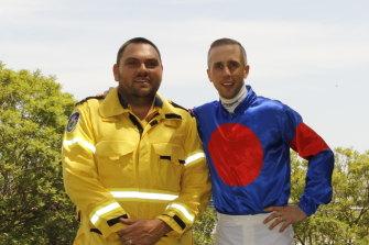 RFS volunteer  Clinton Cox  with jockey Brenton Avdulla ahead of the bushfire appeal meeting at Randwick on Saturday