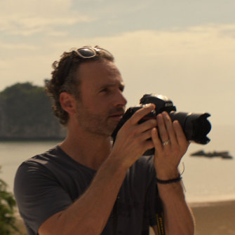 English actor Andrew Lincoln plays photographer husband Cameron Bloom.