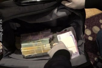 Cash seized when Serbian police stormed the Belgrade hotel.