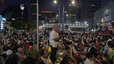 Demonstrators pray during their protest, which is being held during Ramadan.