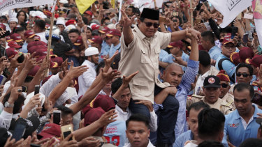 Prabowo greets supporters at a campaign rally in March.