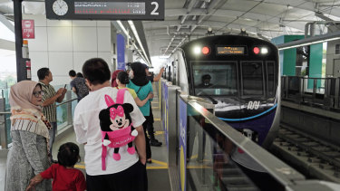 Passengers on Jakarta's new Mass Rapid Transit (MRT) system, which began operation this month.