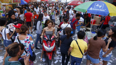 Election campaign materials litter the street as the country's midterm elections draw to a close in Manila.