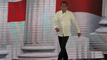 Indonesian President Joko Widodo arrives on stage for the fourth presidential debate.