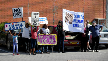 Protesters waiting to greet Prime Minister Malcolm Turnbull during a visit to a supermarket in Ceduna to view a demonstration of the cashless debit card in 2016.