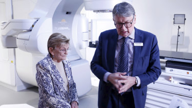 Professor David Ball and Maureen Chrul with the machine that allowed her to be treated for stage one lung cancer in only four visits, compared to over 30.