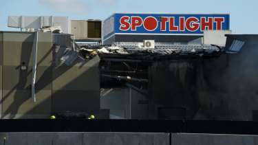 Damage to the Spotlight store at DFO after a plane crash that killed all five on board.