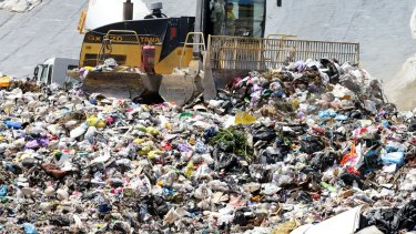 A waste levy in Queensland is proposed to stop New South Wales firms dumping in Queensland and to re-invigorate recycling.