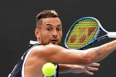 Nick Kyrgios shows his style at Melbourne Park on Saturday and admits to being disappointed compatriot Alex de Minaur is missing the Australian Open through injury.