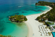 Travel concept: sandy beach and hotels near the blue lagoon, from above, Boracay, Philippines. Seascape with beach on tropical island. Summer and travel vacation concept. Getty image for Traveller. Single use only.