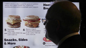 Scott Morrison admires the breakfast options on a 'smart' McDonald's drive-through menu during his visit to Chicago.