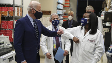 US President Joe Biden wears a protective mask while greeting Kizzmekia Corbett, the immunologist who had a key role in developing a US response to the coronavirus.
