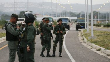 Members of the Venezuelan army and National Guard block the main access to the Tienditas International Bridge that links Colombia and Venezuela on Thursday.