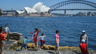 Tourists at Sydney's Mrs Macquarie's Chair.
