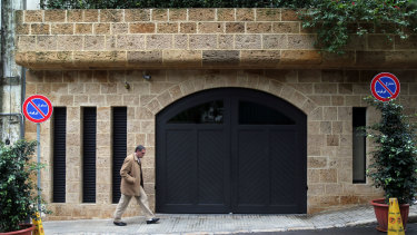 A pedestrian passes the garage at the property of Carlos Ghosn, former head of Nissan and Renault, in Beirut, Lebanon.