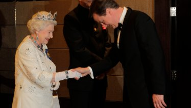The Queen receives PM David Cameron at a Commonwealth Heads of State banquet in 2011.
