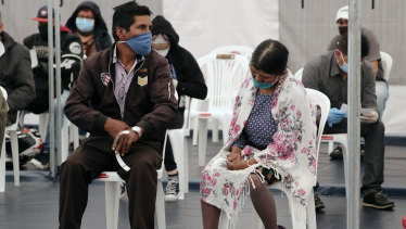 Patients in Quito, Ecuador. wait to be treated for COVID-19 inside a tent set up outside the Instituto de Seguridad Social Sur hospital, which is exclusively treating coronavirus patients.