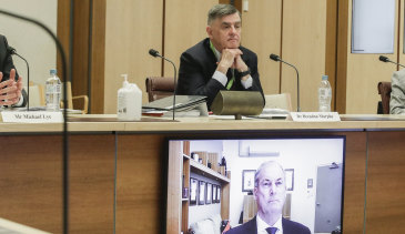 Department of Health secretary Brendan Murphy (seated) and Aged Care Minister Richard Colbeck (appearing via videoconference) at a Senate select committee hearing in Canberra this week.