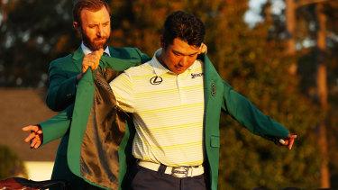 Hideki Matsuyama of Japan is awarded the Green Jacket by 2020 Masters champion Dustin Johnson.