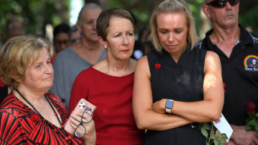Queensland's domestic violence minister Di Farmer (centre) with Red Rose Foundation chief executive Betty Taylor and domestic violence board member Kelli Morton (right).