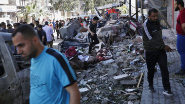 People in Gaza City inspect the rubble of the Abu Hussein building that was hit by an Israeli air strike early on Wednesday morning.