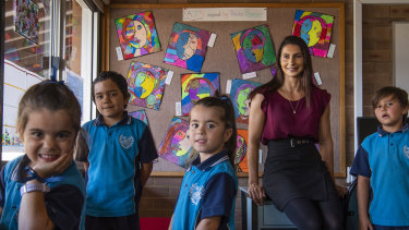 Nicole Wade, principal, with Campbellfield Public School Indigenous students.