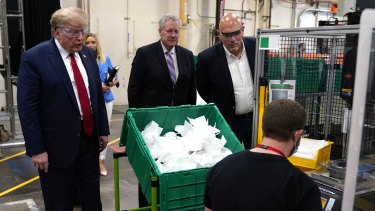 President Donald Trump tours an N95 mask manufacturing plant in Phoenix, Arizona.