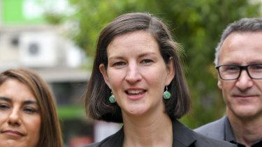 Melbourne MP Ellen Sandell, centre.