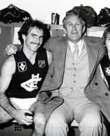 Ken Hunter is congratulated by Prime Minister Malcolm Fraser after winning the 1982 grand final.
