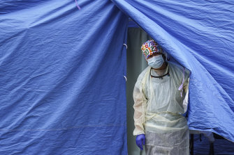 A medical worker at a COVID-19 mobile testing site in the Brooklyn borough of New York.