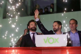 Ultra-nationalist Santiago Abascal waves to supporters after his Vox party polled well.