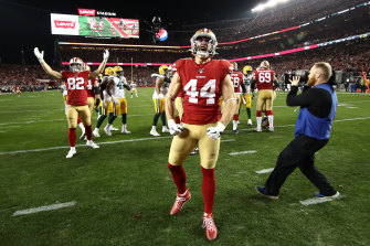 49ers players celebrate after winning the NFC championship and qualifying for the Super Bowl.