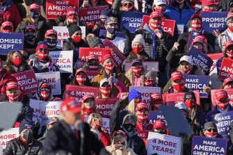 Supporters listen as President Donald Trump speaks at a campaign rally at the Wilkes-Barre Scranton International Airport.