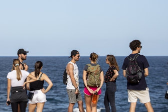 Young People gather at Clovelly beach despite pleas to self-isolate and stay home on Friday.