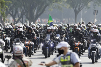 Bolsonaro (centre), leads motorcycle enthusiasts who gathered in a show of support for the President.