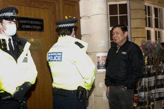 Kyaw Zwar Minn, locked out of the Myanmar embassy, talks to London police.