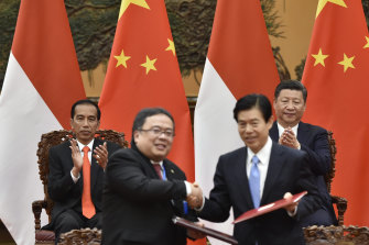Indonesia's President Joko Widodo, left, and Chinese President Xi Jinping, applaud during a deal-signing ceremony on the sidelines of the Belt and Road Forum in Beijing in 2017.