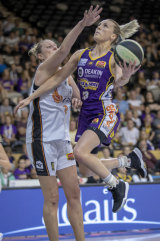 Boomer Maddie Garrick flies to score against the Fire's Suzi Batkovic.