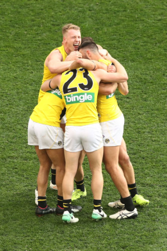 Richmond Tigers players celebrate after defeating the Adelaide Crows in the 2017 AFL Grand Final.