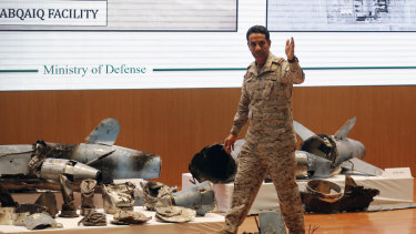 Saudi military spokesman Colonel Turki al-Malki displays what he describes as an Iranian cruise missile and drones.