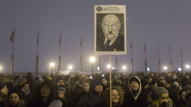 A poster mocking Hungary's Prime Minister Victor Orban is seen during an anti-government march in central Budapest, Hungary.