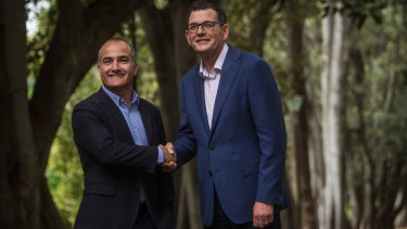 A jubilant re-elected Premier Daniel Andrews (right) on a Sunday stroll with his deputy and friend James Merlino.