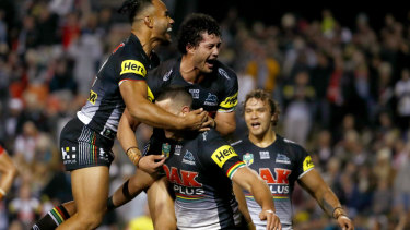 Leading the way: The top-of-the-table clash between Penrith and St George Illawarra on Saturday night was watched by a full house at Panthers Stadium.