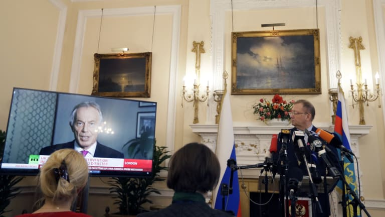Russian Ambassador Alexander Yakovenko looks towards a screen showing former British Prime Minister Tony Blair, as he speaks during a press conference about current news events, at his residence in London on Friday.