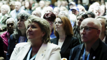 Former prime minister Julia Gillard in the crowd with abuse survivors and their families.