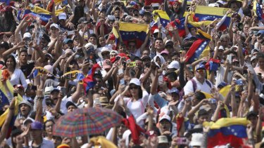 Concert goers unfurl their Venezuelan flags during the Venezuela Aid Live concert on the Colombian side of the Tienditas International Bridge near Cucuta, Colombia.