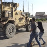 Residents of Syrian city pelt departing US troops with potatoes