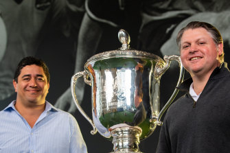 Former Wallabies centre Morgan Turinui  (left)and prop Matt Dunning (right) pose with the Bledisloe Cup in Sydney on Wednesday.