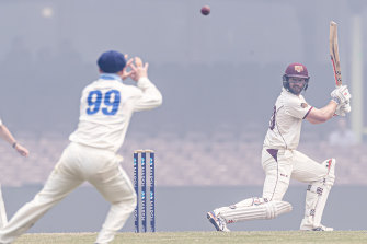 Mathew Gilkes picks the ball out through the smoke to take the catch and dismiss Michael Neser off Harry Conway.